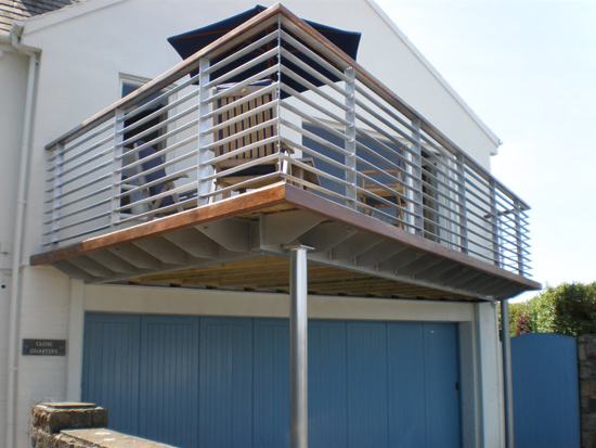 Steel balconies balcony with steel railings the for Stainless steel balcony