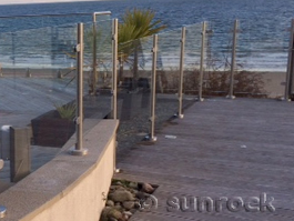 Glass Balustrades and Decking fitted by Sunrock Balconies on The Warren Abersoch