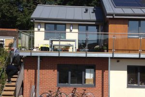 long balcony with steps glass stainless steel balcony