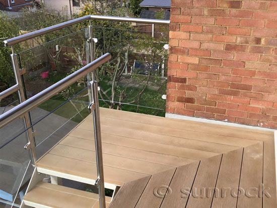 Sunrock glass and steel stair balustrade with composite decking