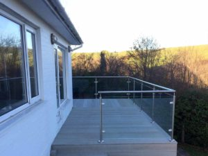 Glass balustrades with smoked oak enhanced grain millboard