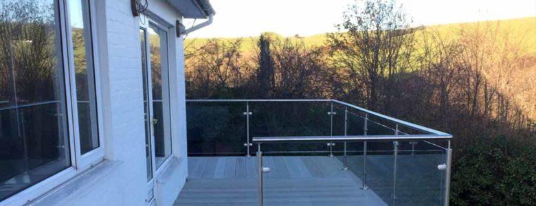 Glass balustrades with smoked oak enhanced grain millboard