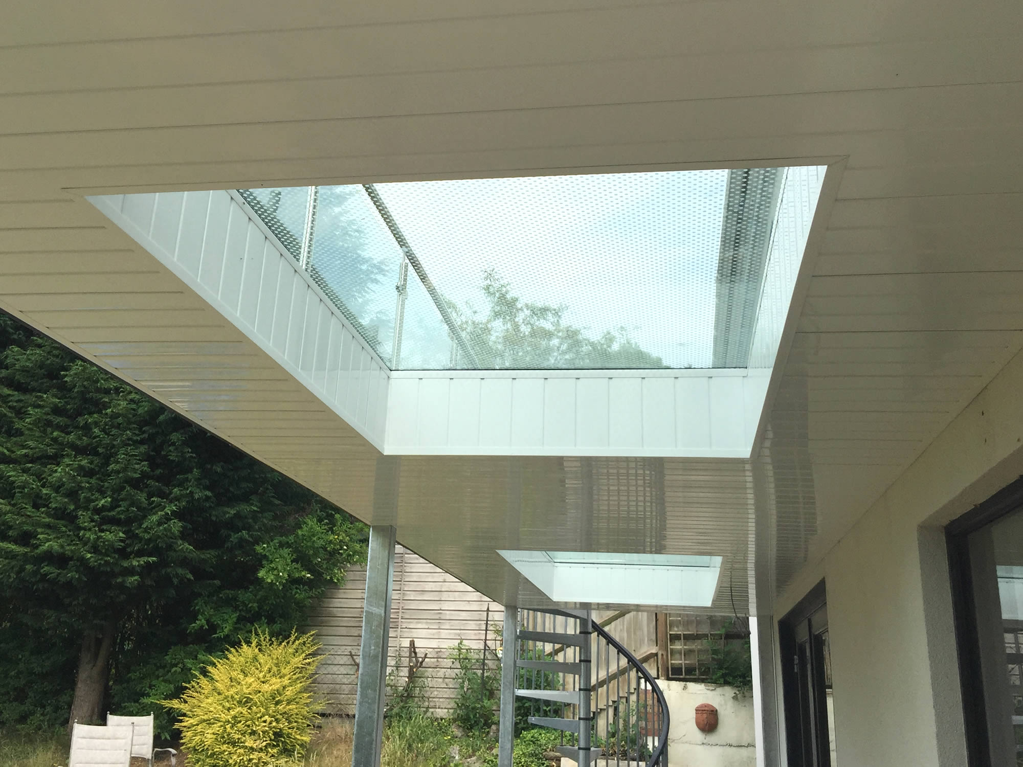 Glass flooring for balconies from sunrock balconies for Glass balcony