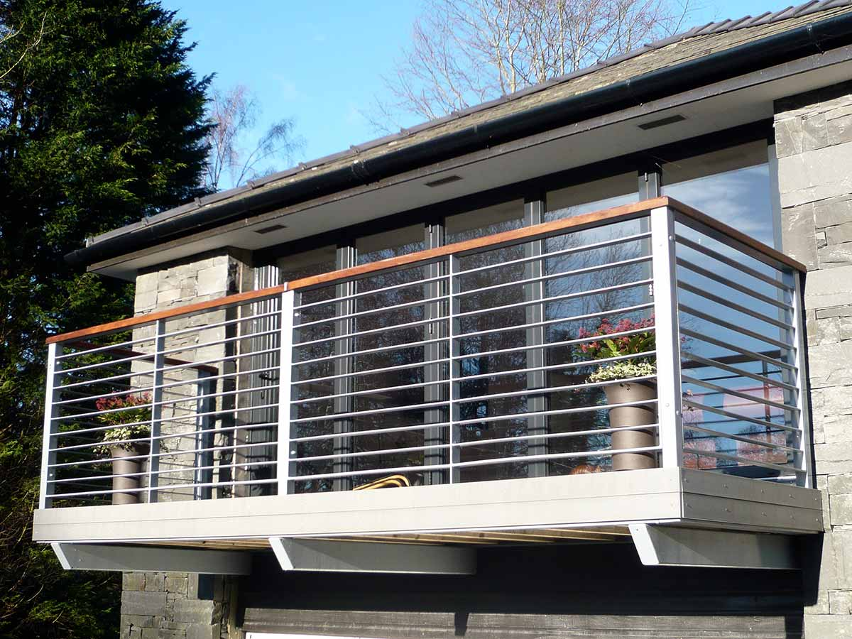 Steel balconies balcony with steel railings sunrock for Balconies or balconies