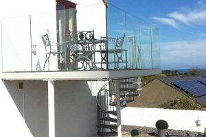 Infinity Glass Balcony with Spiral Staircase
