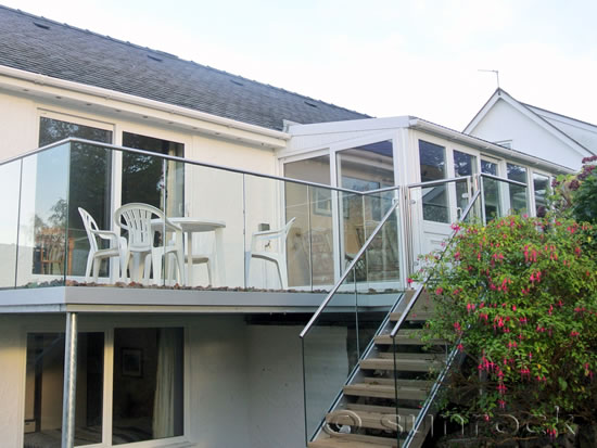 After Installation of Infinity Glass Balcony with Steel Handrail Steps and Gate