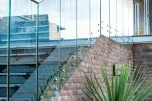 infinity glass balustrades button fix with handrail