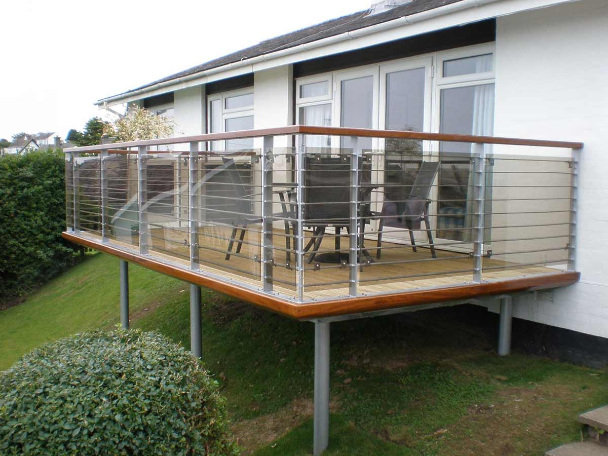 Steel balcony with tinted glass sunrock balconies for Glass balcony railing