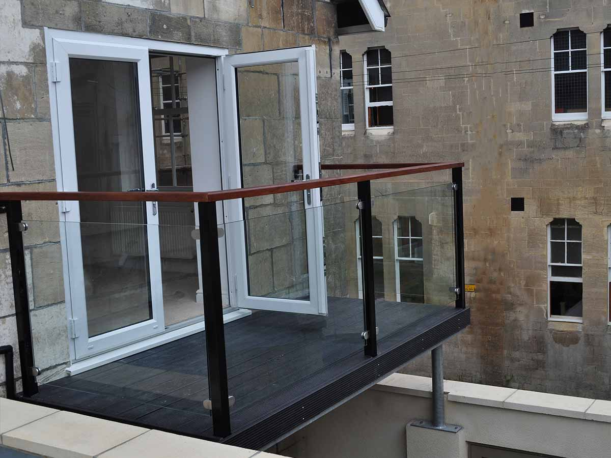 Steel balconies balcony with steel railings sunrock for Stainless steel balcony