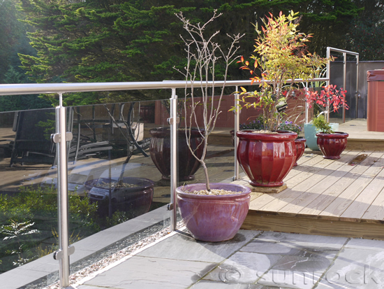 Glass & stainless steel balustrades installed with slate and wooden decking area for a hot tub