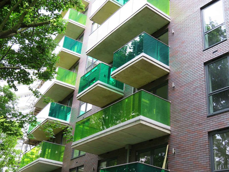 Flats infinity glass balconies green tinted glass Battersea London