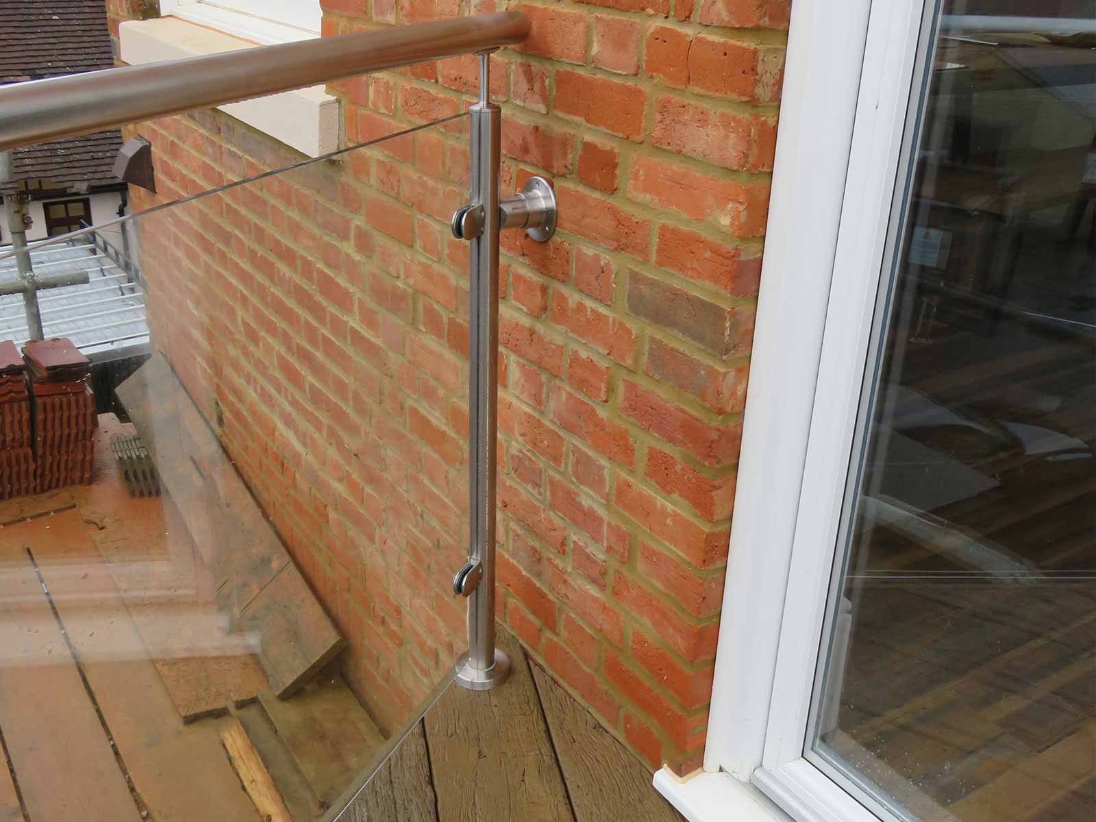 roof terrace glass steel balustrades fixed to brick
