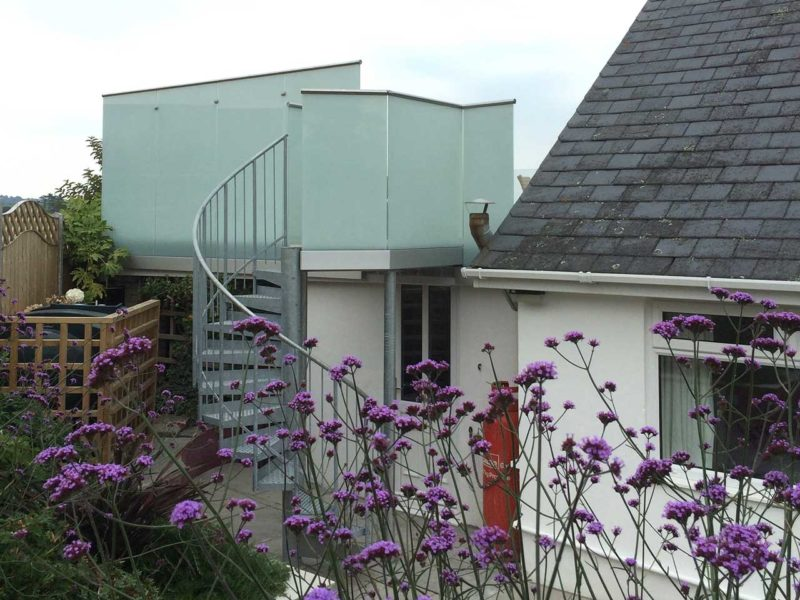 spiral staircase with privacy glass balustrades