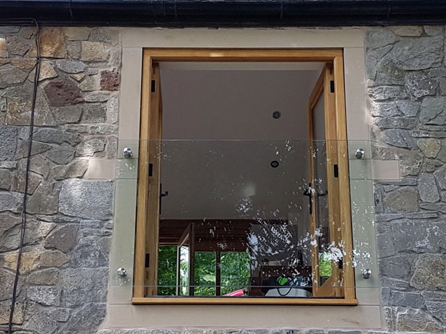 glass juliet balcony south wales fixed to stone