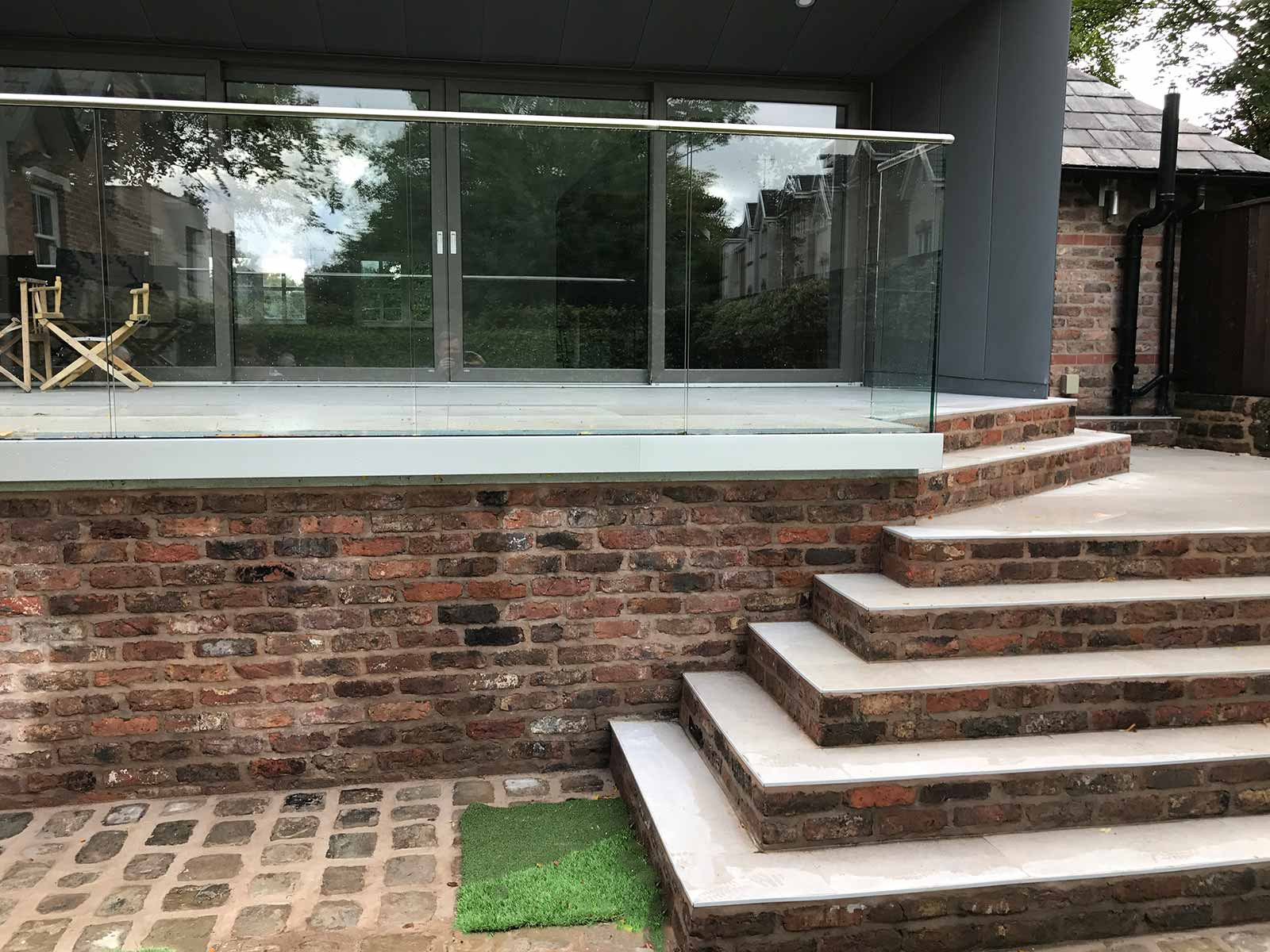 New Balcony With Covered Area In Liverpool » Glass Balustrades Raised Patio  Steps Liverpool